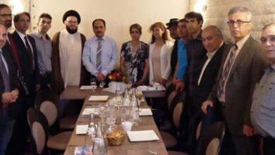 صورة ندوة لأعضاء سابقين في زمره  مجاهدي خلق الإيرانية في باريس بحضور وكلمة العلامة الحسيني